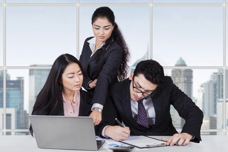 subordinates: Portrait of the female team leader leads her subordinates when working in the office Stock Photo