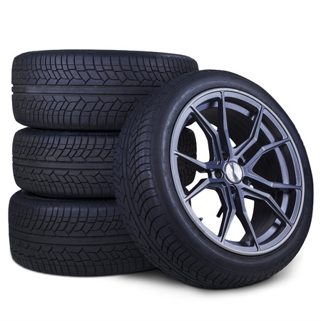Closeup of four tires with racing rim and black texture, isolated over white background