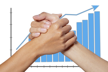 Partner hand between a businessman and woman on graph background photo