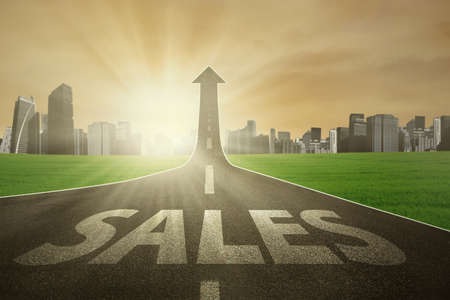 increase sales: Road with Sales word, turning into arrow upward symbolizing the way to increase sales