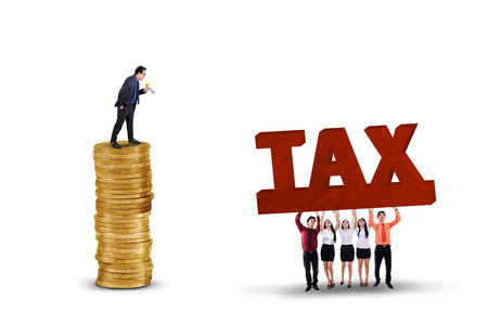 Business leader giving orders on his employees to lift a tax text, isolated on white background photo
