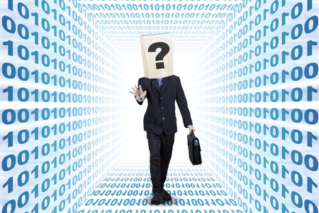 Confused businessman with cardboard head finding the way on the binary aisle photo