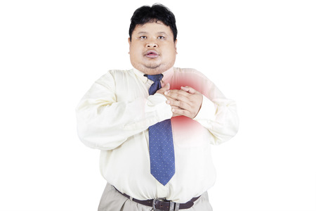 Obesity businessman getting heart attack. isolated on white background photo