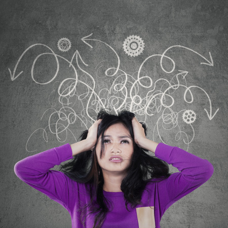 frustrated student: Portrait of beautiful young girl with casual clothes, having messy thought and looks stressed