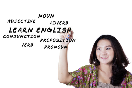 noun: Portrait of lovely female high school student writes English materials on whiteboard