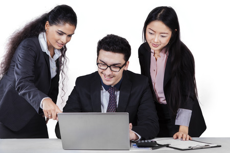Portrait of multiracial business people in business meeting using a laptop computer, isolated on white background photo