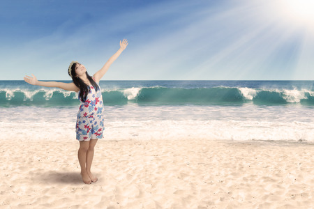 inhale: Joyful woman enjoying freedom. shoot on the beach