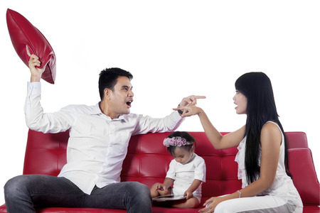 Asian parents quarrel in studio while their baby playing digital tablet, isolated over white photo