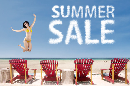 korean woman: Summer sale clouds with sexy woman jumping over beach chairs