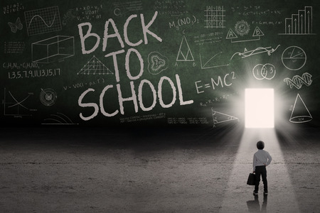 toward: Back to school: Text of back to school on the blackboard with a door on the board