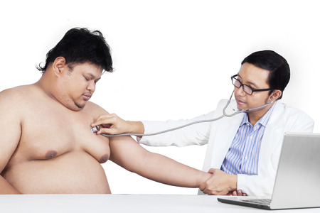 Portrait of fat person doing checkup with his doctor, isolated on white photo