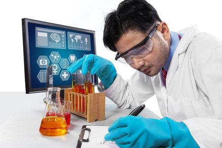 hispanic students: Portrait of young scientist observing the experiment in the laboratory and writes the report on the clipboard