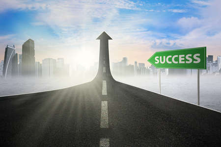 road to success: Guidepost with Success word pointing at the road turning into arrow upward symbolizing the road to success Stock Photo