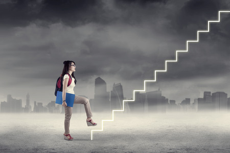 back up: College student stepping up on stairs to gain her success