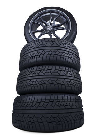 Closeup of a pile of new black tires with detailed texture, isolated on white background photo