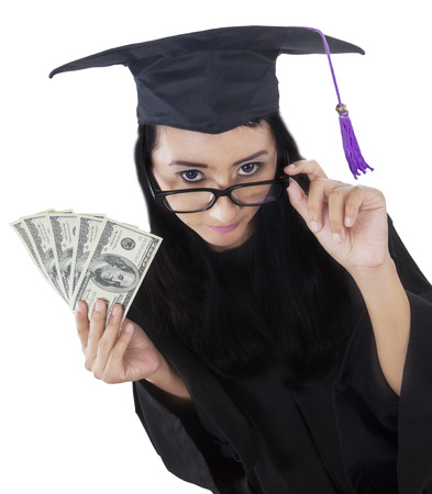 academic robe: Unique perspective of female bachelor holding money dollar, isolated on white background