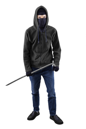 law breaker: Male bandit standing in the studio while wearing balaclava and holding a crowbar