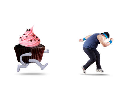 hallucination: Young man with overweight body refuse to eat cupcake and try to escape