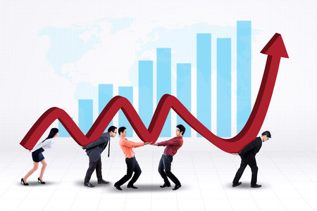 upward graph: Portrait of young business team work together to carry a business graph with upward arrow