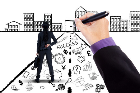 Back view of female entrepreneur standing on a road with business doodles looking at a chance door photo
