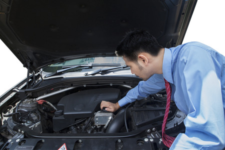 hood: Young entrepreneur looking and checking the broken car machine Stock Photo