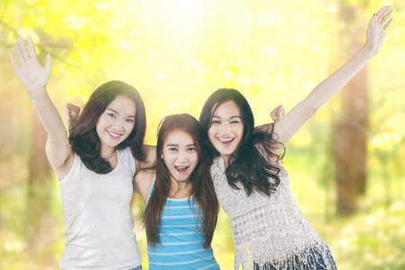 asian group: Portrait of beautiful teenage girls having fun together to enjoy summer holiday in the nature