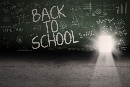 back light: Back to school: Text of back to school on the blackboard with a door on the board
