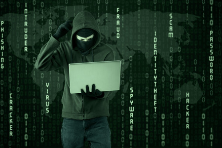 internet security: Portrait of hacker getting difficult password with binary code background