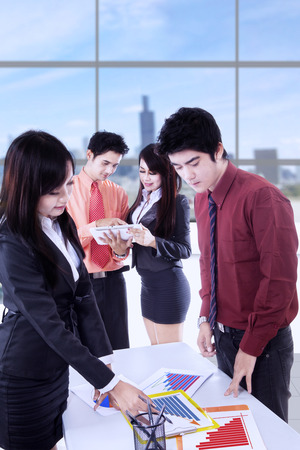 business finance: Portrait of young business team in business meeting to discuss business strategy and finance