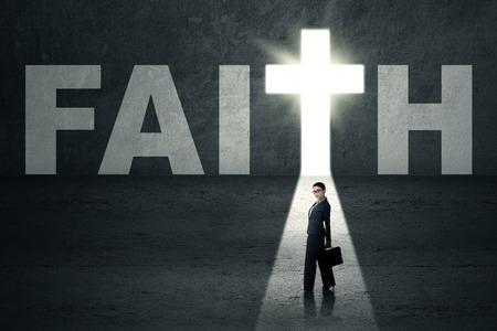 christians: Confident businesswoman standing in faith door