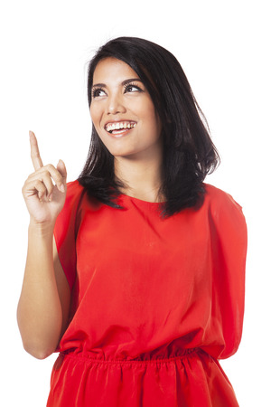 advertising woman: Portrait of smart young woman smiling happy and looks get an idea with hand pointing upward Stock Photo