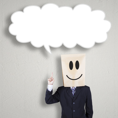 business idea: Male entrepreneur with cardboard head standing under empty bubble speech. Concept of finding business idea