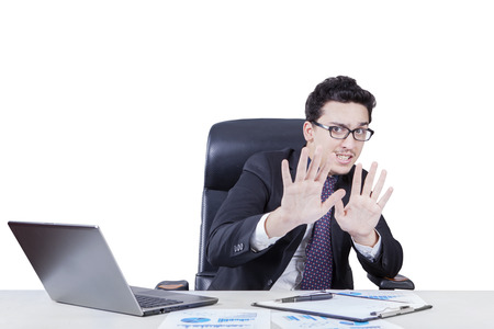 scolded: Portrait of young businessman with fear expression scolded by someone, isolated on white