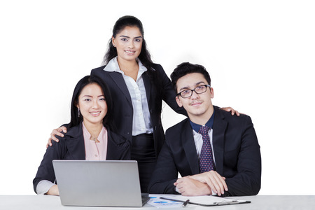 multi racial: Portrait of multi racial business team with three members looking and smiling on the camera, isolated on white