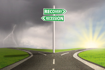road to recovery: Road sign with recession and recovery words pointing at the option highway