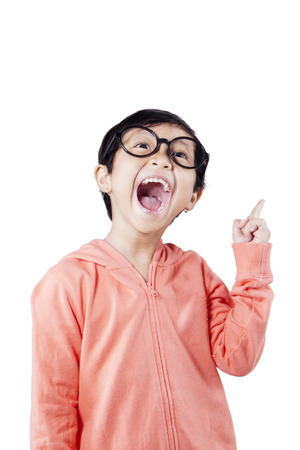 asian children: Portrait of cheerful child with casual clothes and glasses looks gets idea, isolated over white background
