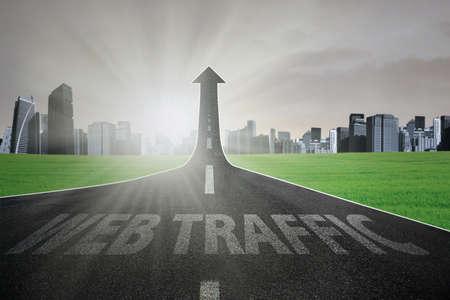 web traffic: Empty highway turning into arrow upward with web traffic text, symbolizing growing web traffic Stock Photo