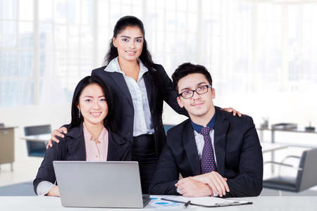 business asia: Group of multi racial businesspeople with formal suit looking and smiling on the camera in the office
