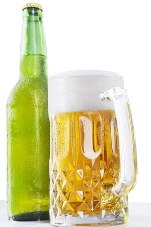 dewy: Fresh beer in a big glasses with froth and a dewy bottle, isolated over white background