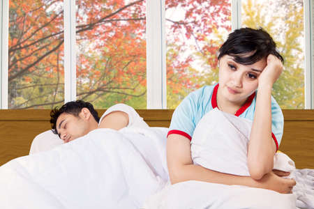 couple fight: Portrait of young woman can not sleep on bedroom with her husband