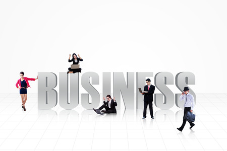 computer isolated: Business people with BUSINESS text isolated on white