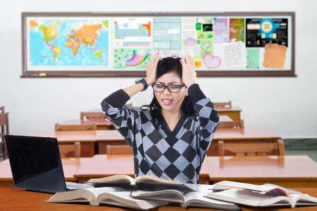 bored student: Portrait of high school student studying in the classroom and looks stressful Stock Photo