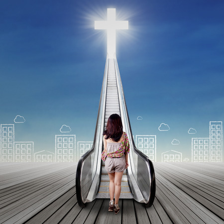 spiritual journey: Adolescent girl in a spiritual journey and walk on the stair to the heaven Stock Photo