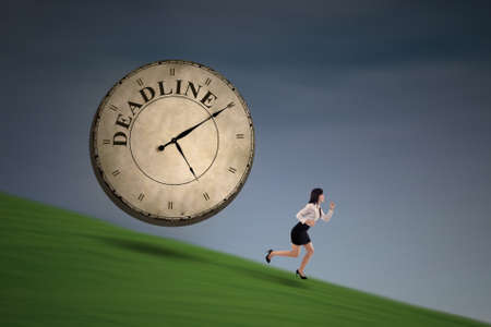 employe: Asian businesswoman is running out of deadline on a hill