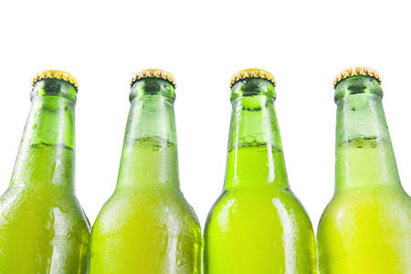 green beer bottle: Fresh beverage on the dewy and green beer bottle, isolated on white background. Concept of fresh drink