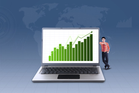 asian businessman: Business bar chart on laptop with businessman standing next to it on blue background