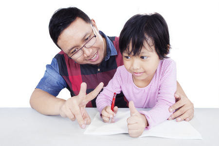 mathematic: Portrait of young father helping his daughter for doing homework and learn to count with her finger, isolated on white