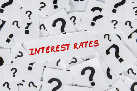 Interest rates words surrounded by question marks Foto de archivo