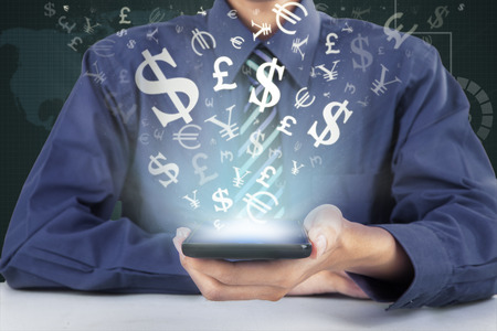 coming: Male worker holding a mobile phone with money symbol coming out from the screen, symbolizing making money online