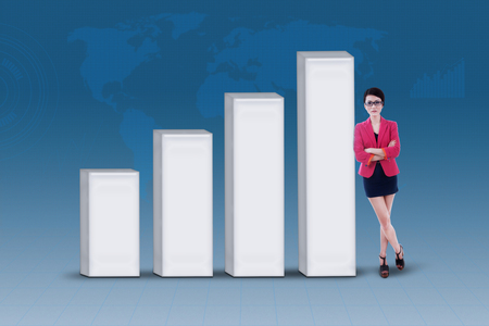 enhancement: Businesswoman and increasing bar chart on blue world map background